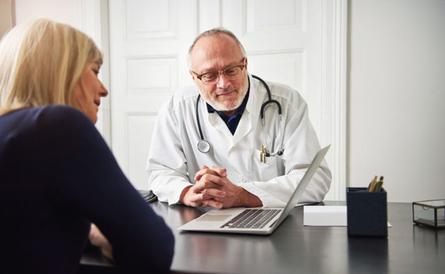Doctor discussing options with patient for tips for shoulder replacement recovery blog