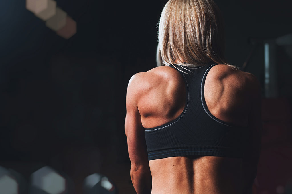 muscular woman for returning to sports after shoulder surgery blog