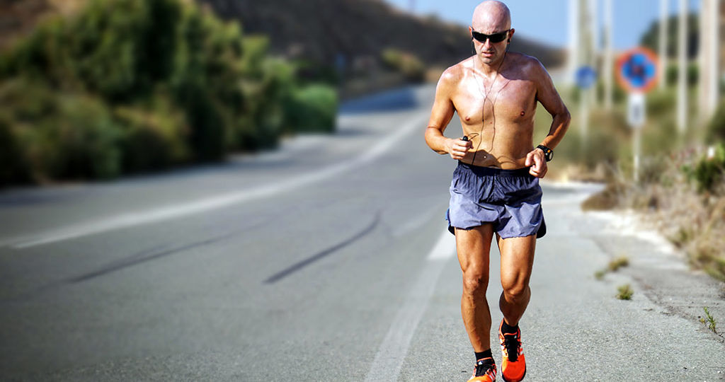Middle aged man running shirtless