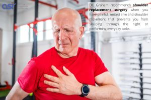 Senior man in need of a reverse shoulder replacement surgery suffering from pain at the gym - Austin Shoulder Institute
